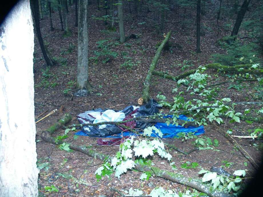 Jennifer L. Patterson, 24, of Saratoga Springs died early Saturday morning, July 10, 2010, after a falling tree crashed onto the tent she was sleeping in while camping in Lake Luzerne. The tent and pieces of the tree are pictured. (Courtesy Warren County Sheriff's Department)
