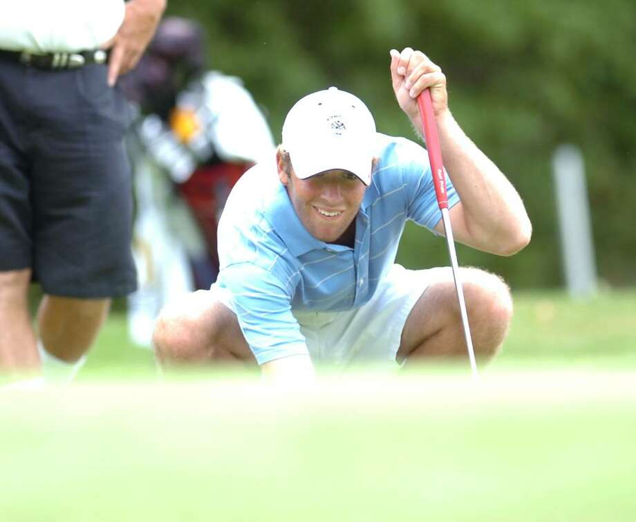 George Tischler lines up a putt on one during the 66th Town of Greenwich Men's Golf Tournament, July 10, 2010, at the Griffith E. Harris Golf Course, Greenwich. Photo: Bob Luckey / Greenwich Time