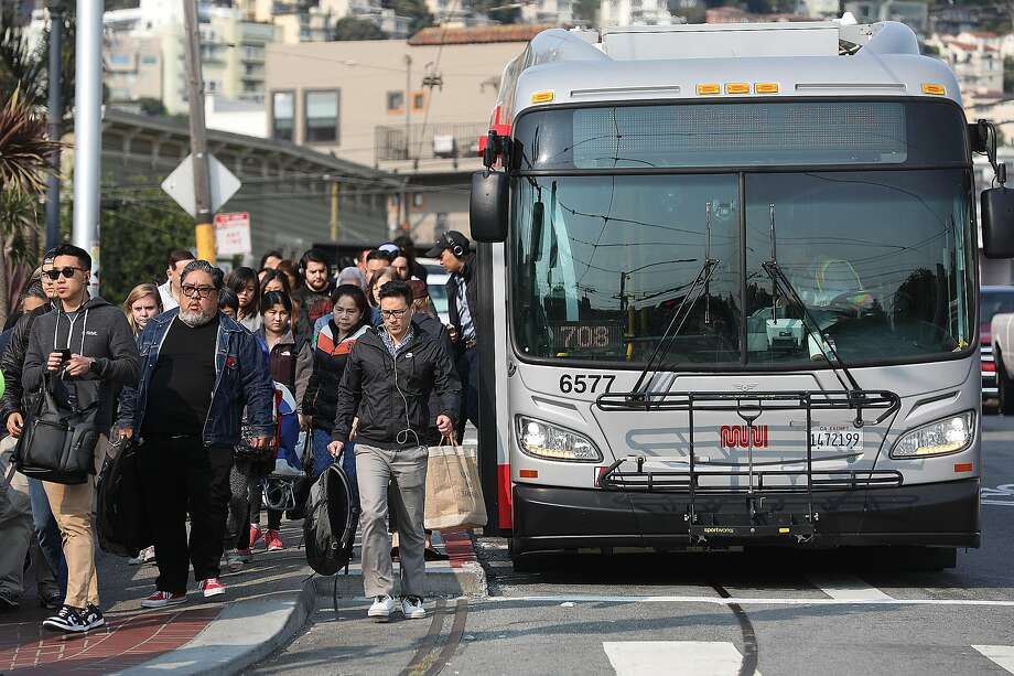 Muni commuters coming off the L Taravel bus head into the Castro station on Thursday, Aug. 9, 2018 in San Francisco, Calif. Photo: Liz Hafalia / The Chronicle