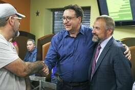 Former U.S. Rep. Pete Gallego shakes hands with campaign strategist Christian Archer at his side as he meets with his supporters at an election night party the Taqueria Mexico restaurant on Somerset Rd. on July 31, 2018.