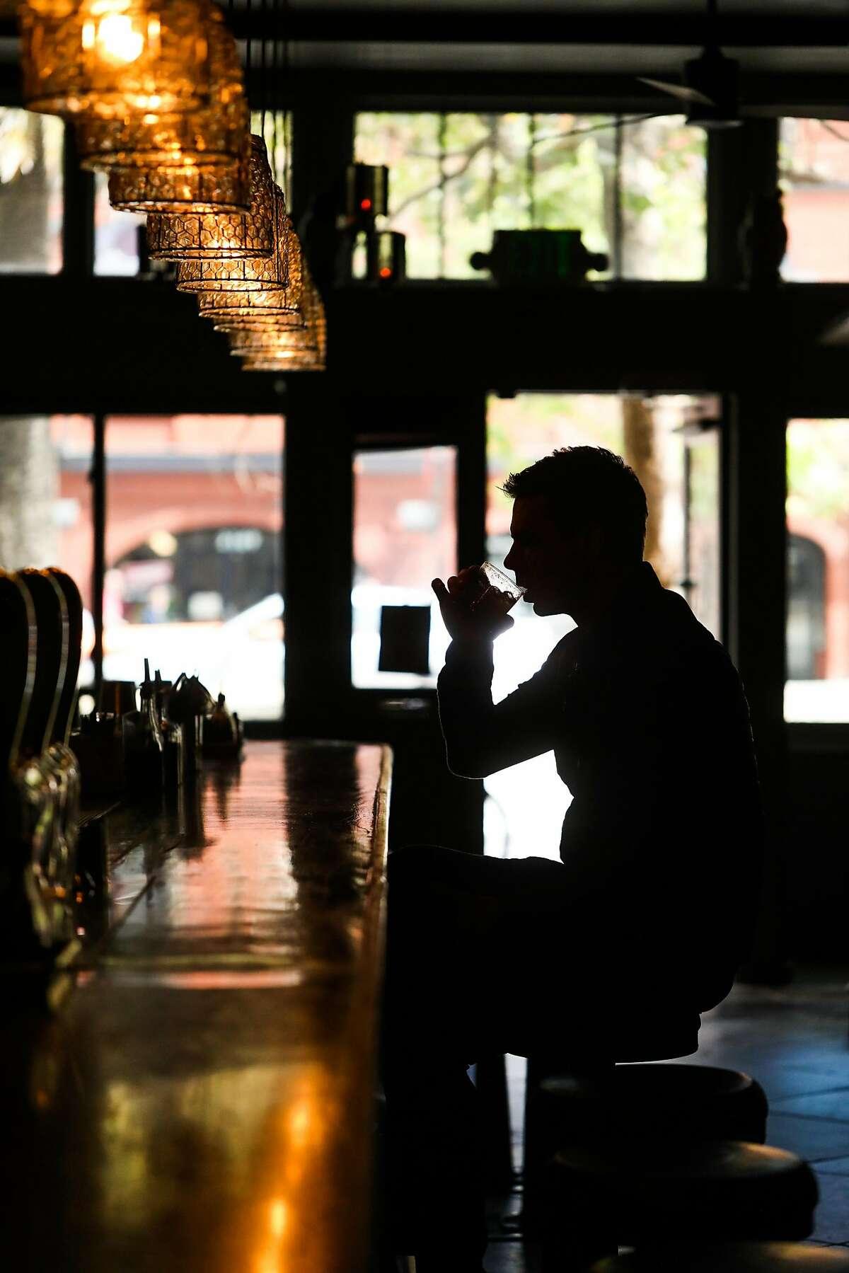 Jason Bishop has a drink at Blackbird bar in San Francisco, California, on Thursday, July 26, 2018.