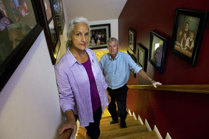Debra Tice and her husband Marc Tice, stand on the stairway of their home surrounded by photographs of their family. The Tice family has been on the search for their missing son Austin Bennett Tice, who went missing in Syria August 14, 2012.