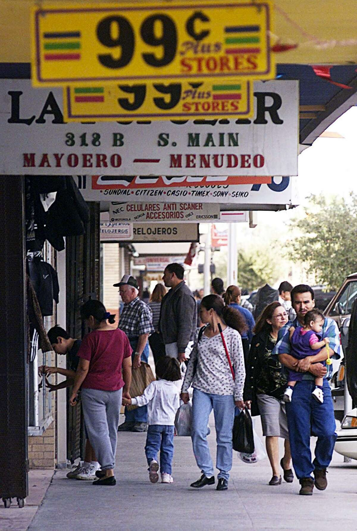 A group of Mexican citizens window shop Main Street in downtown McAllen, in 2001. An NPR report recently focused on neighbors here who are friends but don't discuss politics. They should.