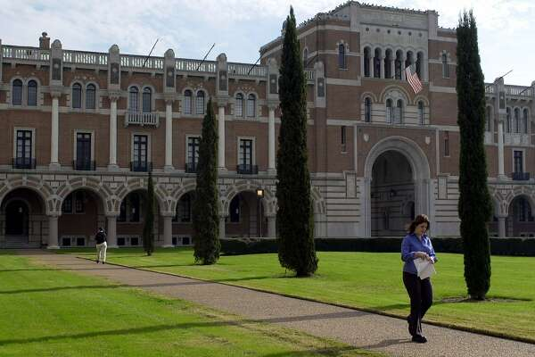 ADVANCE FOR WEEKEND JAN. 27-28--An unidentified woman walks past Rice University's Lovett Hall, the oldest building on campus, Tuesday, Jan. 23, 2001, in Houston. Classes commenced at Rice on Sept. 23, 1912, 12 years after the death of its benefactor, William Marsh Rice. (AP Photo/Pat Sullivan). HOUCHRON CAPTION (10/11/2004) SECMETRO: BUILDING TIES: An unidentified woman walks past Rice University's Lovett Hall in this 2003 file photo.