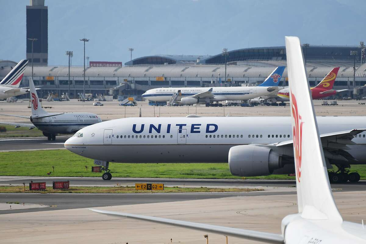 A United Airlines Boeing 777 aircraft waits to take off at Beijing airport, where the carrier has suspended some flights from the U.S.