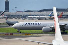 "A United Airlines Boeing 777 aircraft waits to take off at Beijing airport on July 25, 2018. Beijing hailed ""positive steps"" as major US airlines and Hong Kong's flag carrier moved to comply on July 25 with its demand to list Taiwan as part of China, sparking anger on the island. / AFP PHOTO / GREG BAKERGREG BAKER/AFP/Getty Images"