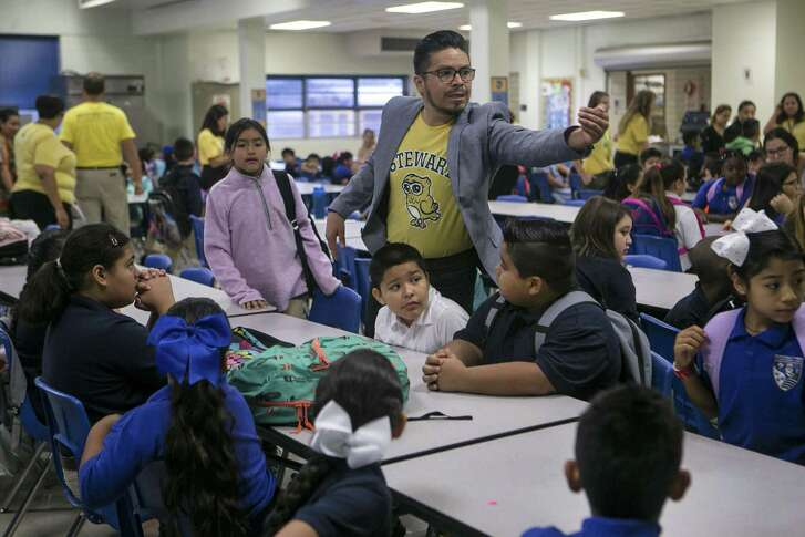 Fourth grade teacher Miguel Rodriguez instructs his  students on the first day of class at Democracy Prep at the Stewart Campus Aug. 13, 2018. The school is run by the New York-based Democracy Prep charter network while remaining an SAISD school.