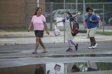 Students joyfully walk to their first day of class at Democracy Prep at the Stewart Campus last week. The school is run by the New York-based Democracy Prep charter network while remaining an SAISD school.
