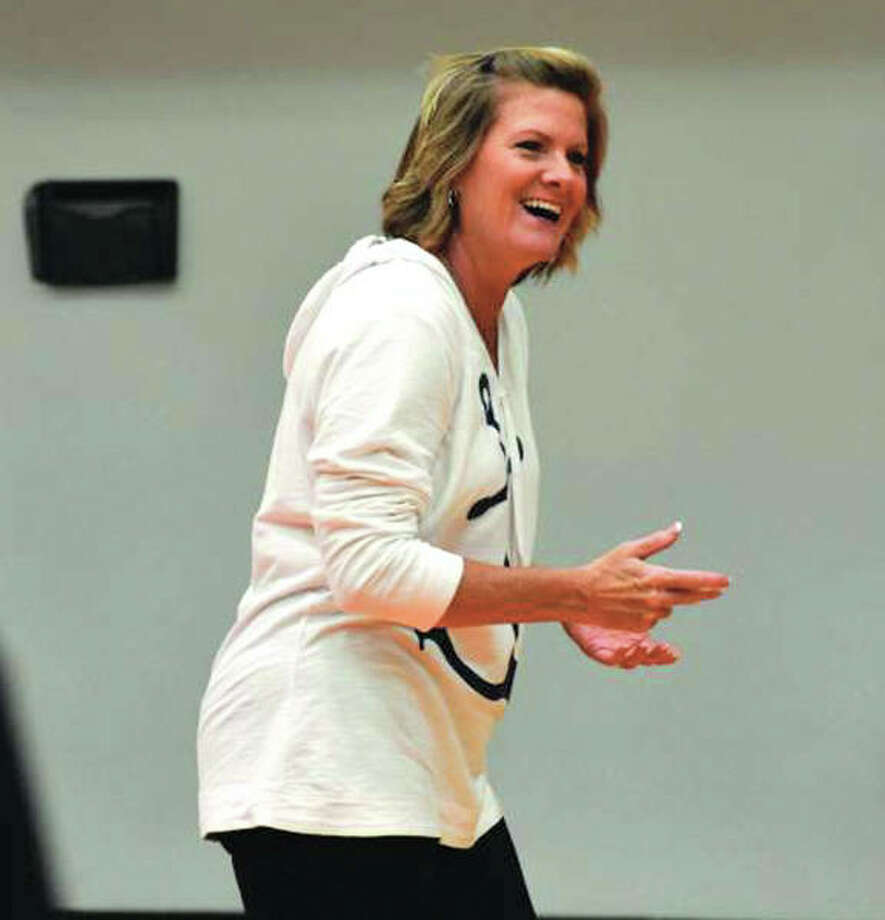 Edwardsville girls volleyball coach Lisa Orlet laughs during the second day of practice for the Tigers on Thursday at Lucco-Jackson Gym in Edwardsville. Photo:       Matthew Kamp / Hearst Newspapers