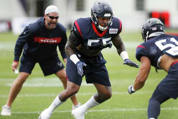 Benardrick McKinney runs a drill with Dylan Cole, right, two parts of an ultra-deep linebacking corps for the Texans.