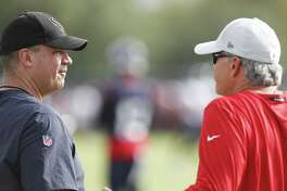 Houston Texans head coach Bill O'Brien talks to former Indianapolis Colts head coach Chuck Pagano during training camp at the Methodist Training Center on Monday, Aug. 13, 2018, in Houston.