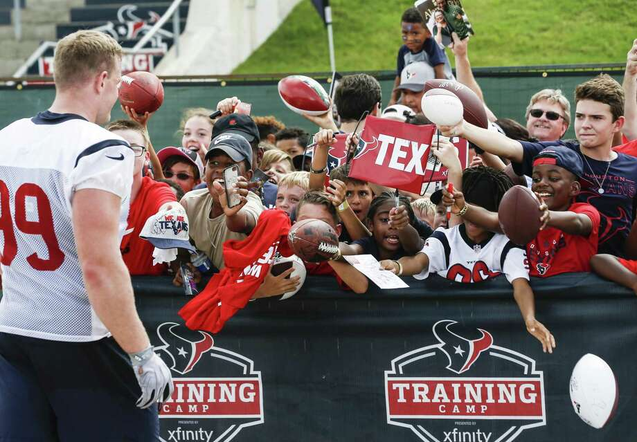 PHOTOS: Texans H-E-B commercials 2019  Houston Texans defensive end J.J. Watt (99) walks up to a group of fans to sign autographs during training camp at the Methodist Training Center on Monday, Aug. 13, 2018, in Houston.  >>>Browse through the photos for a preview of the Texans' new H-E-B commercials ...  Photo: Brett Coomer, Staff Photographer / Houston Chronicle / © 2018 Houston Chronicle