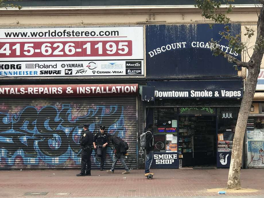 A girl friends said is 14 years old was arrested at this smoke shop shown here moments after the incident on Aug. 13, 2018. Witnesses said San Francisco police officers slammed the girl against the ground and a car and she went limp. She was transported from the scene in an ambulance. Photo: J.K. Dineen / San Francisco Chronicle