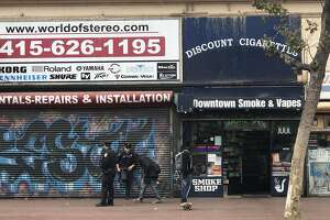 A girl friends said is 14 years old was arrested at this smoke shop shown here moments after the incident on Aug. 13, 2018. Witnesses said San Francisco police officers slammed the girl against the ground and a car and she went limp. She was transported from the scene in an ambulance.