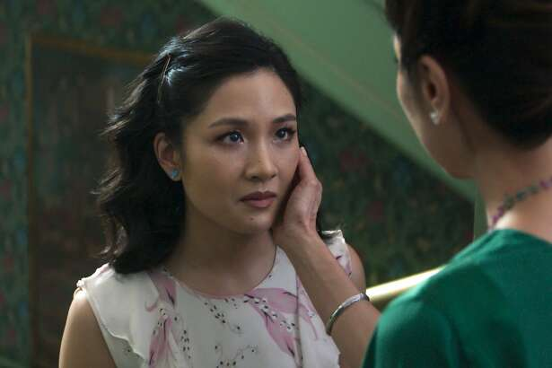 "This image released by Warner Bros. Entertainment shows Constance Wu, left, and Michelle Yeoh in a scene from the film ""Crazy Rich Asians."" (Warner Bros. Entertainment via AP)"