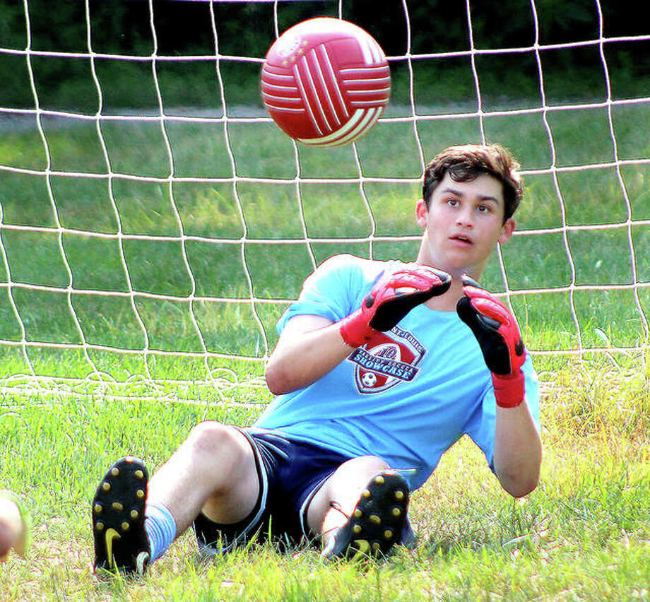 Alton High sophomore goalie Owen Macias keeps a close eye on the ball during Monday's practice at North Elementary School in Godfrey. Photo:       Pete Hayes | The Telegraph