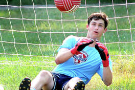 Alton High sophomore goalie Owen Macias keeps a close eye on the ball during Monday's practice at North Elementary School in Godfrey.