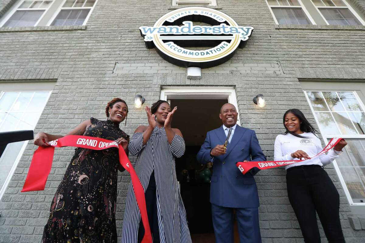 Wanderstay Houston owner Deidre Mathis (second from left) and Houston Mayor Sylvester Turner perform a ribbon cutting ceremony Monday, Aug. 13, 2018, in Houston.
