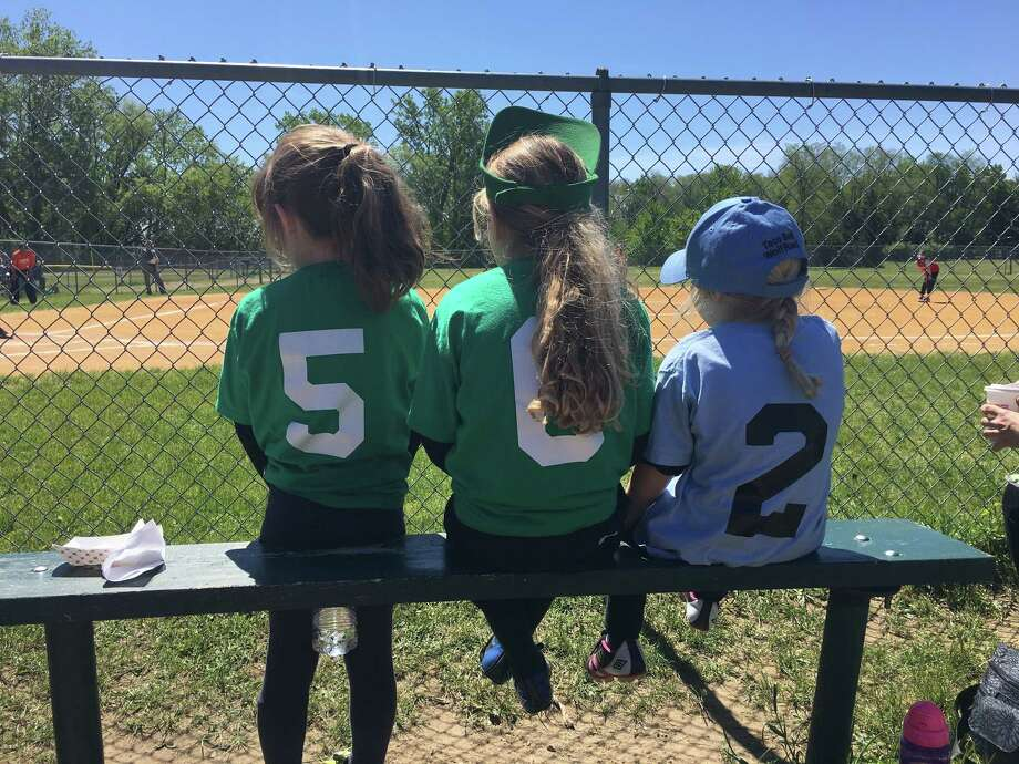 """These young gals hope for a chance to play as they watch from the sidelines at Westland Hills Little League. From left, 8-year-old Virginia """"Gigi"""" Diefendorf, with cousins, Chloe, 8, and Camilla, 5, Diefendorf. All are from Albany and are the granddaughters of Mark Diefendorf of Albany."""