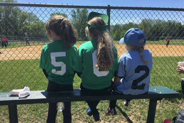 "These young gals hope for a chance to play as they watch from the sidelines at Westland Hills Little League. From left, 8-year-old Virginia ""Gigi"" Diefendorf, with cousins, Chloe, 8, and Camilla, 5, Diefendorf. All are from Albany and are the granddaughters of Mark Diefendorf of Albany."