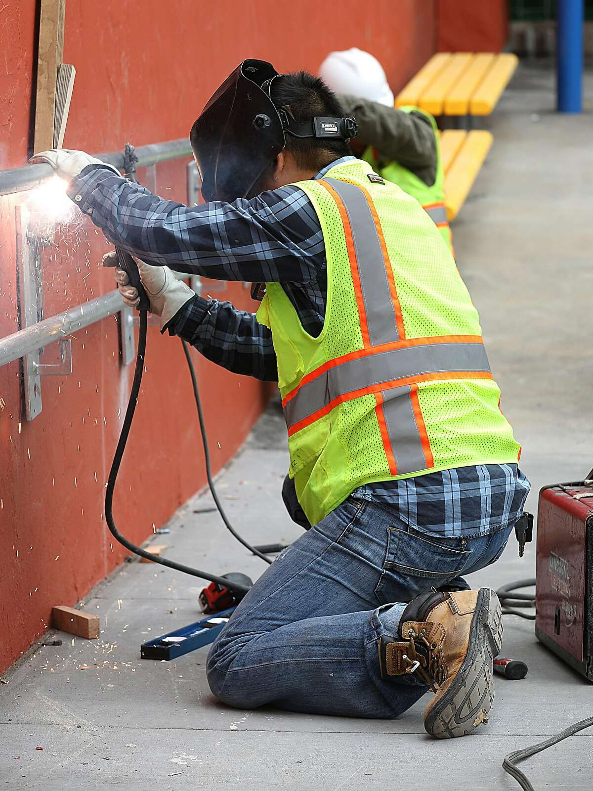 A hand rail is weld in the school yard at Redding Elementary school on Monday, Aug. 13, 2018 in San Francisco, Calif. The school has moved forward with construction and hopes to get reimbursed.