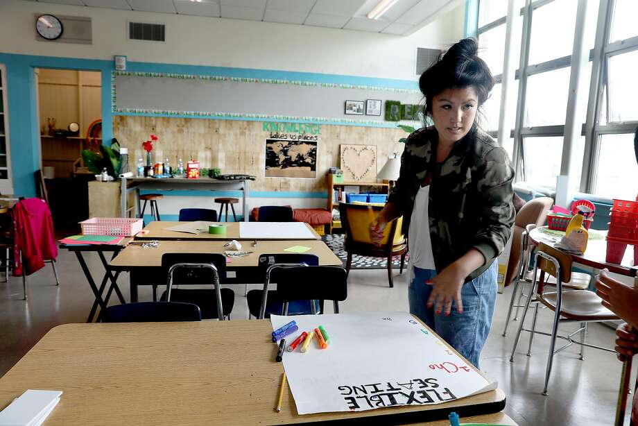 Teacher Dana Rees prepares her fourth-fifth-grade classroom at San Francisco's Redding Elementary for the start of school next week. Redding is waiting for funds from a state bond. Photo: Liz Hafalia / The Chronicle