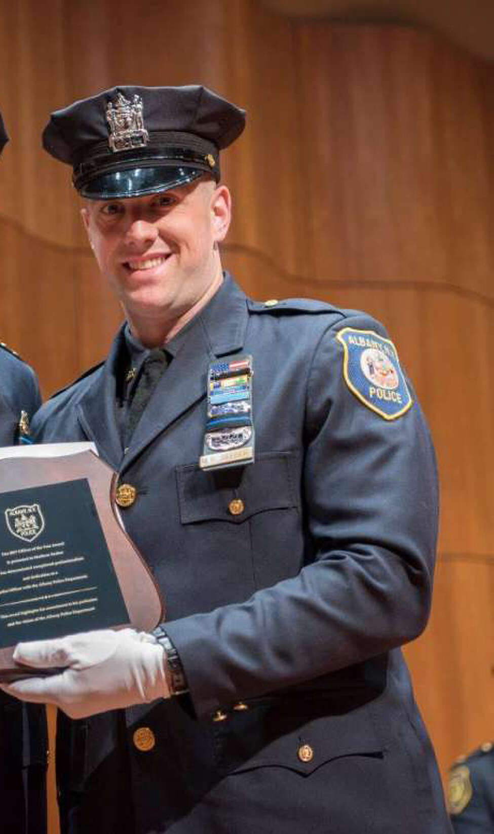 Matthew Seeber receives the Officer of the Year Award from the Albany Police Department on May 15, 2018.