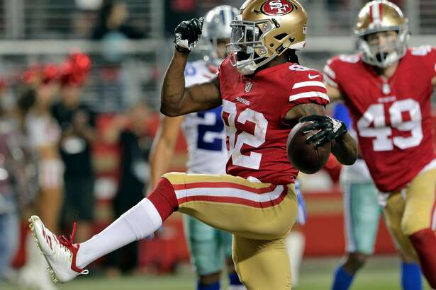 49ers wide reciever RIchie James (82) high steps in the end zone as he celebrates his game winning touchdown in the final seconds of the fourth quarter during the 49ers game against the Dallas Cowboys at Levi's Stadium in Santa Clara, Calif., on Thursday, August 9, 2018.