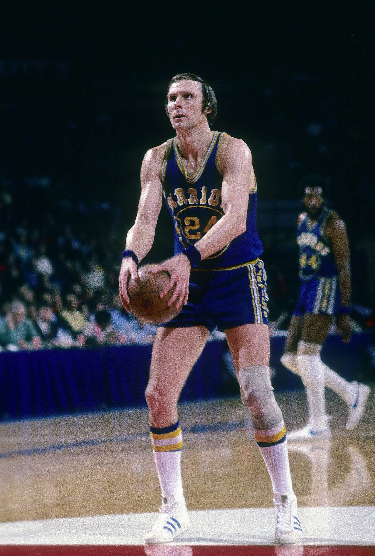 BALTIMORE, MD - CIRCA 1974: Rick Barry #24 of the Golden State Warriors is at the free-throw line against the Washington Bullets during a circa 1974 NBA basketball game at the Capital Center in Baltimore, Maryland. Barry played for the Warriors from 1972 - 77. (Photo by Focus on Sport/Getty Images)