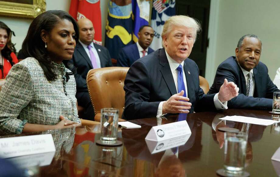 "FILE - In this Feb. 1, 2017, file photo, President Donald Trump, center, is flanked by White House staffer Omarosa Manigault Newman, left, and  then-Housing and Urban Development Secretary-designate Ben Carson as he speaks during a meeting on African American History Month in the Roosevelt Room of the White House in Washington. Manigault Newman, who was fired in December, released a new book ""Unhinged,"" about her time in the White House. (AP Photo/Evan Vucci, File) Photo: Evan Vucci / Copyright 2017 The Associated Press. All rights reserved."