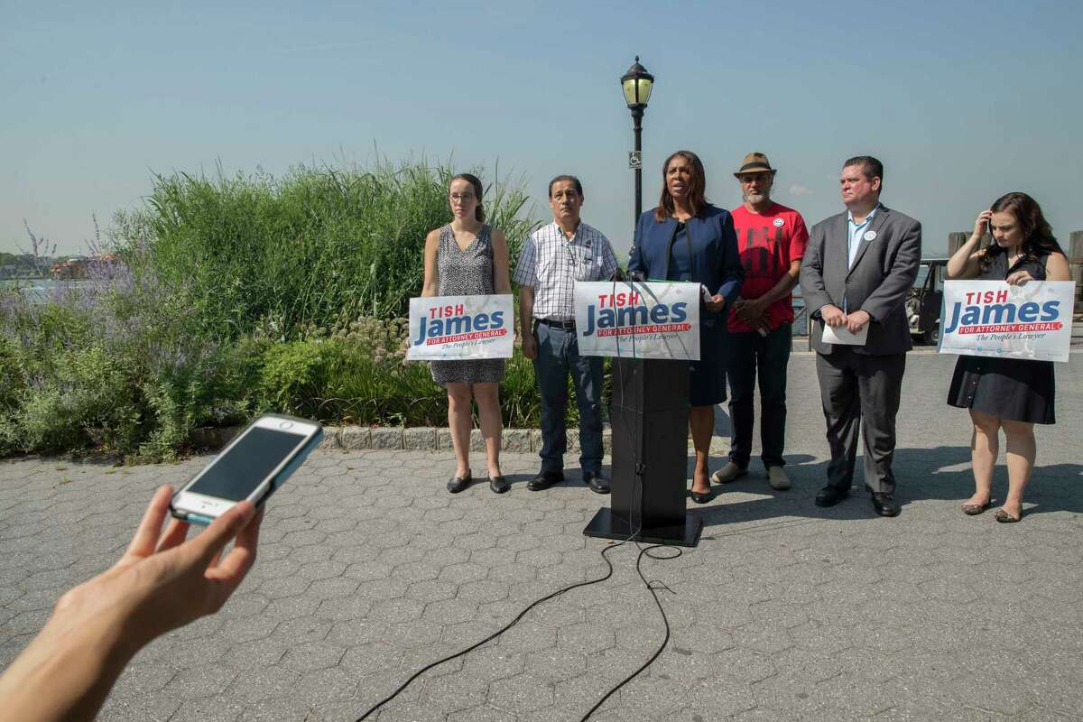 New York City Public Advocate Letitia James, center, speaks during a news conference, Friday, Aug. 10, 2018, in New York. James will face off against Leecia Eve, an attorney who was an aide to Hillary Clinton and Cuomo, Zephyr Teachout, a professor at Fordham Law School, and congressman Sean Patrick Maloney in the Democratic primary race for attorney general.(AP Photo/Mary Altaffer)