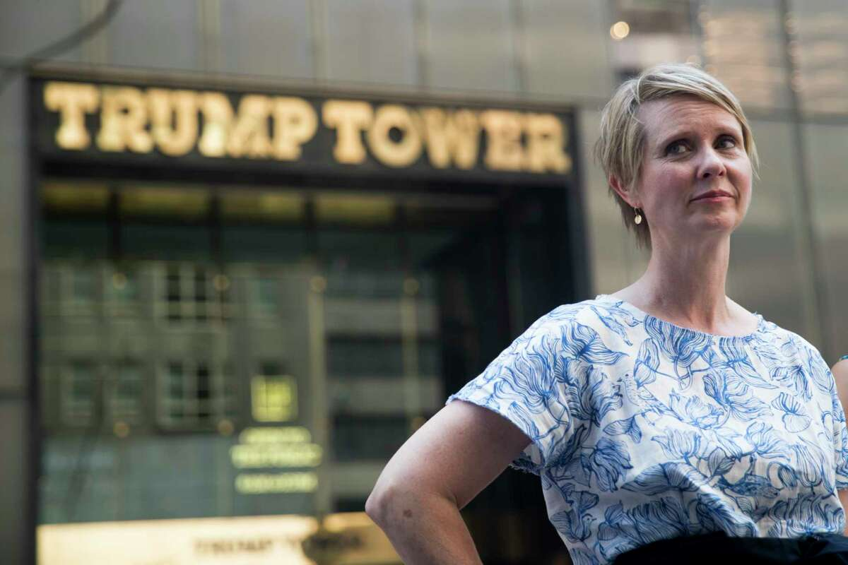 Democratic candidate for governor Cynthia Nixon stands outside Trump Tower before holding a news conference with New York State Attorney General candidate Zephyr Teachout, Wednesday, Aug. 8, 2018, in New York. Nixon and Teachout endorsed each other. (AP Photo/Mary Altaffer)