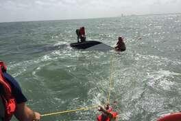 Coast Guard crews rescue three men from a sinking boat near Galveston on Monday, Aug. 13, 2018.