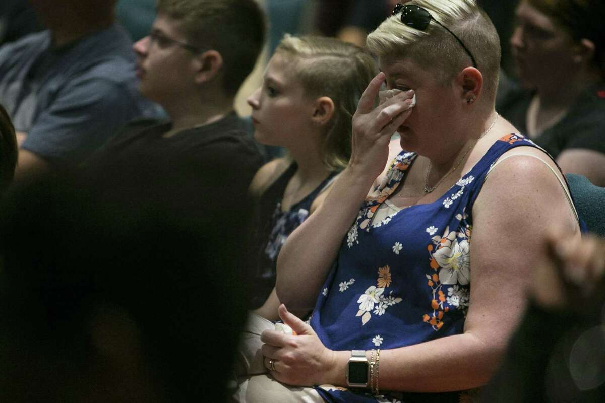 Overcome with emotion as mass shooting case studies are reviewed, Ann Small wipes away tears Monday.