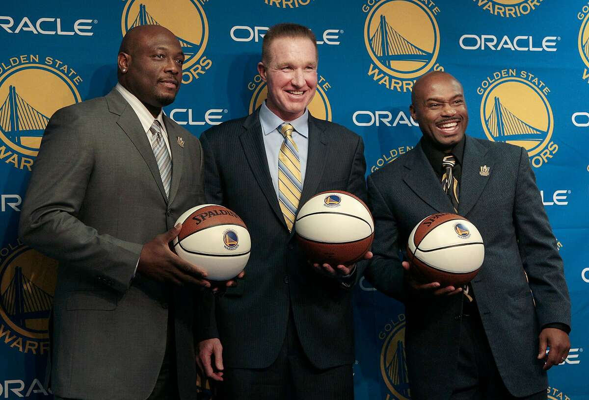 Former Golden State Warriors players, from left, Mitch Richmond,Chris Mullin and Tim Hardaway pose for photographs after a news conference before an NBA basketball game between the Warriors and the Minnesota Timberwolves in Oakland, Calif., Monday, March 19, 2012. Mullin's No. 17 jersey number was to be retired at halftime. (AP Photo/Jeff Chiu)