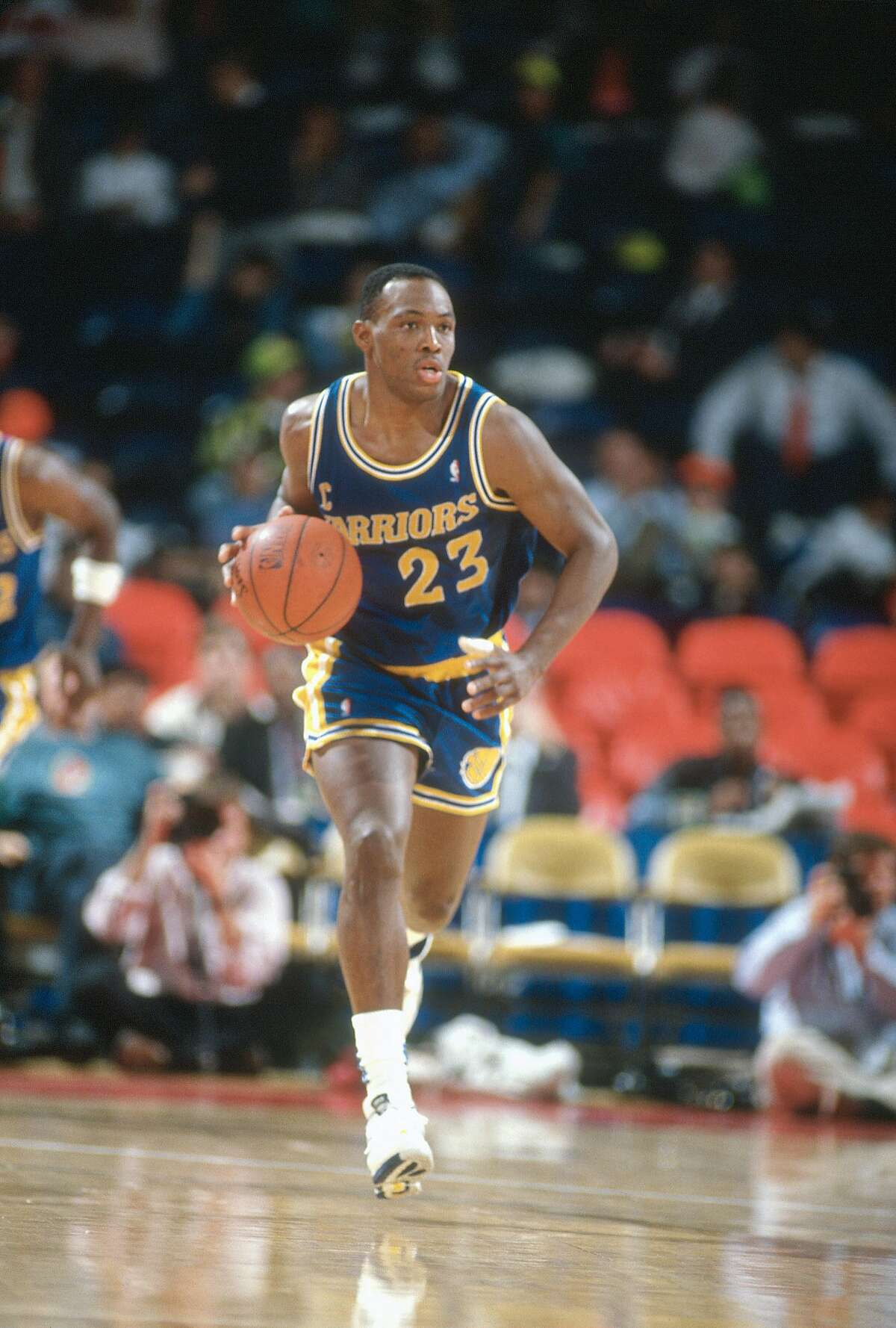 LANDOVER, MD - CIRCA 1990: Mitch Richmond #23 of the Golden State Warriors dribbles the ball up court against the Washington Bullets during an NBA basketball game circa 1990 at the Capital Centre in Landover, Maryland. Richmond played for the Warriors from 1988-91.