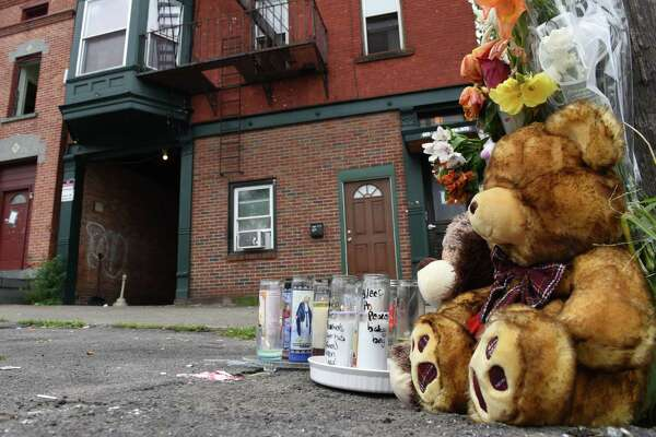 A makeshift memorial was placed outside the State St. apartment building where police recovered a child's body last week on Monday, Aug. 13, 2018, in Schenectady, N.Y. (Will Waldron/Times Union)