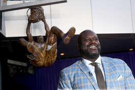 """Former Los Angeles Lakers great Shaquille O'Neal is all smiles after the unveiling of his statue outside Staples Center in Los Angeles on March 24, 2017. O'Neal has joined the Carnival Cruise Line team as its """"Chief Fun Officer."""""""