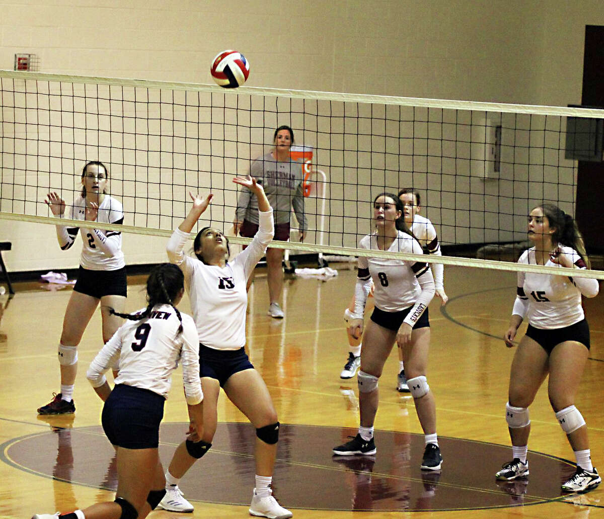 THE SETUP Plainview senior Christen Gonzalez puts up a set assist for senior Kayla Soto (9) during the Princeton Tournament on Saturday in Princeton. The Lady Bulldogs won the silver bracket championship with a 27-25, 25-20 win over Sherman.