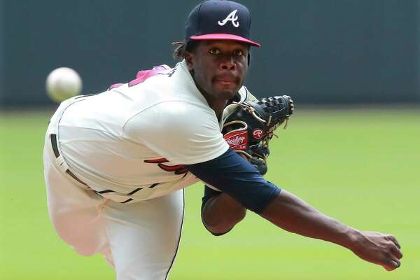 Atlanta Braves Touki Toussaint, making his MLB debut, delivers a pitch against the Miami Marlins during the first inning of a baseball game on Monday, Aug. 13, 2018, in Atlanta. (Curtis Compton/Atlanta Journal-Constitution via AP)