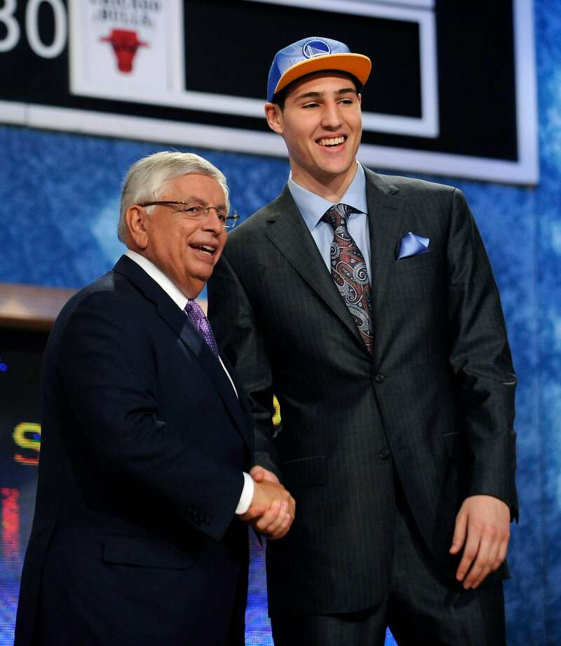 NBA Commissioner David Stern, left, poses with the No. 11 overall draft pick, Washington State guard Klay Thompson, who was selected by the Golden State Warriors in the NBA basketball draft Thursday, June 23, 2011, in Newark, N.J. Photo: Mel Evans / AP