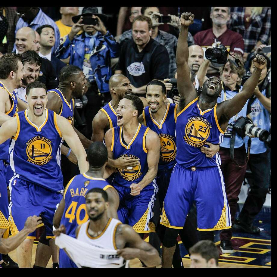 Warriors players celebrate after clinching the NBA title with a win in Game 6 of the 2015 NBA Finals at Quicken Loans Arena in Cleveland. Photo: Carlos Avila Gonzalez / The Chronicle 2-15
