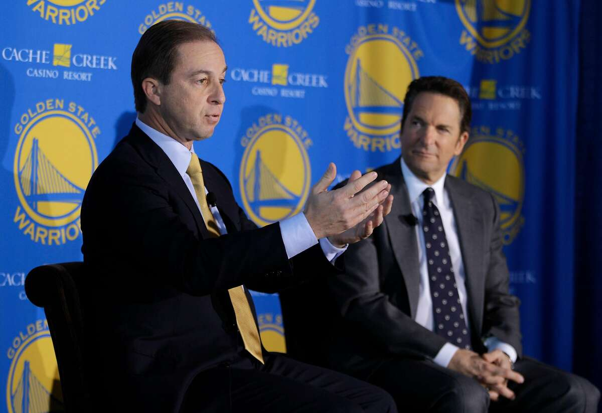 Golden State Warriors new owners Joe Lacob, left, gestures as Peter Guber, right, looks on during their introduction at a luncheon in San Francisco, Monday, Nov. 15, 2010. The sale of the Golden State Warriors NBA basketball team was completed last week to an ownership group headed by Lacob and Guber. Lacob will serve as co-executive chairman, CEO and governor and Guber will serve as co-executive chairman and alternate governor.