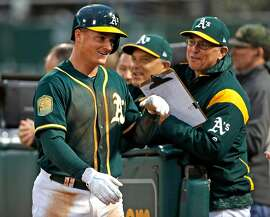 Oakland Athletics' Matt Chapman returns to dugout after scoring on Jed Lowrie's 2-run double in 3rd inning against Seattle Mariners during MLB game at Oakland Coliseum in Oakland, Calif. on Monday, August 13, 2018.