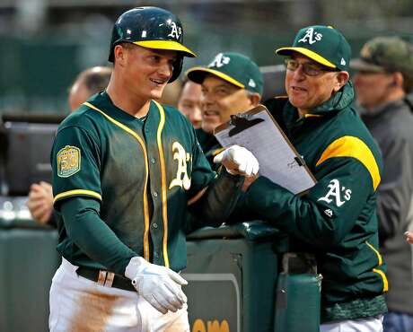 Oakland Athletics' Matt Chapman returns to dugout after scoring on Jed Lowrie's 2-run double in 3rd inning against Seattle Mariners during MLB game at Oakland Coliseum in Oakland, Calif. on Monday, August 13, 2018. Photo: Scott Strazzante / The Chronicle
