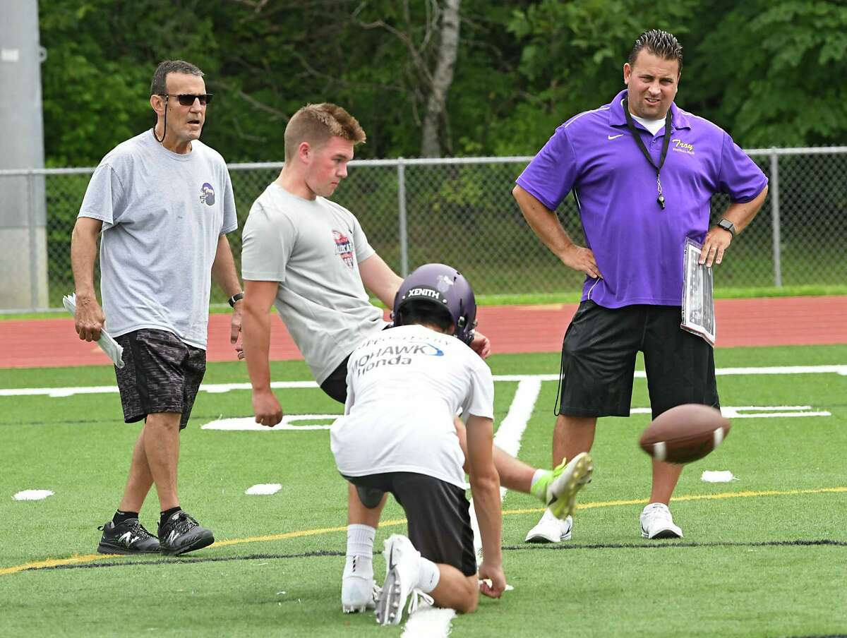 Troy High School head coach Bob Burns, right, watches as Maxwell Ellis kick the ball as he works with the team during the first day of football practice Monday Aug. 13, 2018 in Troy, N.Y. (Lori Van Buren/Times Union)