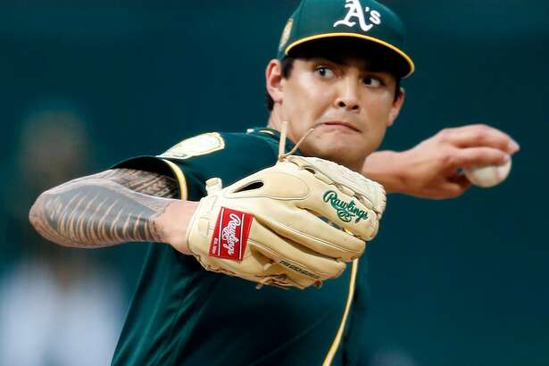 Oakland Athletics' Sean Manaea delivers in 1st inning against Seattle Mariners during ML:B game at Oakland Coliseum in Oakland, Calif. on Monday, August 13, 2018.