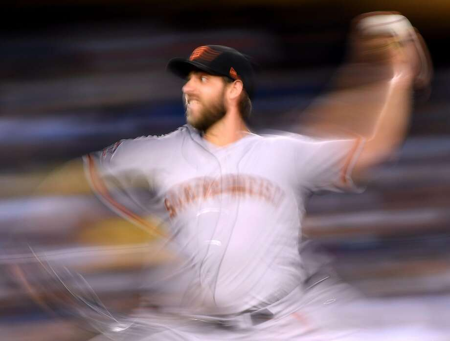 LOS ANGELES, CA - AUGUST 13:  Madison Bumgarner #40 of the San Francisco Giants pitches during the third inning against the Los Angeles Dodgers during the first inning at Dodger Stadium on August 13, 2018 in Los Angeles, California.  (Photo by Harry How/Getty Images) Photo: Harry How / Getty Images