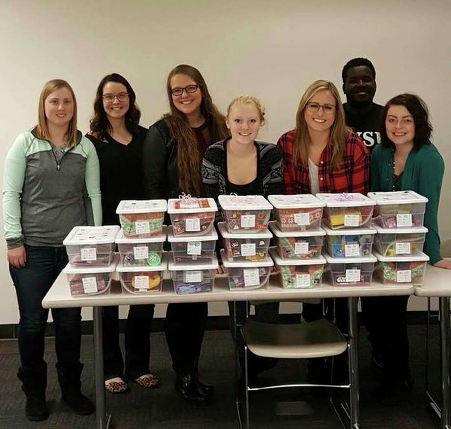 Members of the SVSU chapter of the National Society of Collegiate Scholars gather behind boxes of toys collected for The Jared Box Project, a nonprofit benefiting children in hospitals. Hali Motley, former president of the chapter, is pictured in the center. (Photo provided/Hali Motley)