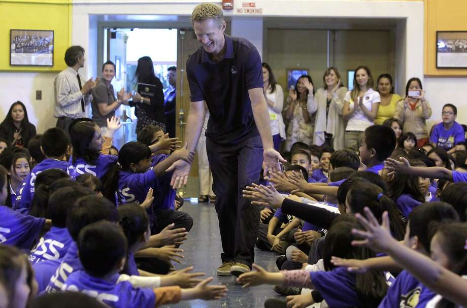 Warriors head coach Steve Kerr arrives to read to students at Longfellow Elementary School in San Francisco on Sept. 17, 2014. Photo: Paul Chinn / The Chronicle 2014